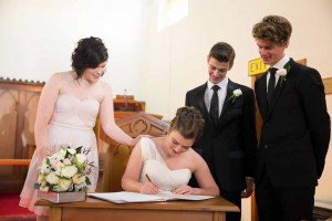 Signing register - wedding at St Hilda's